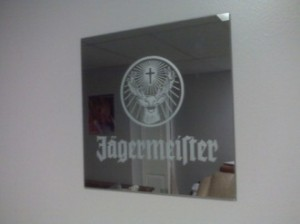 Etching of a Jagermeister mirror glass.