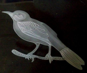 Etched bird in 2 stages.