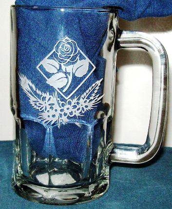 Another etched mug with flower.