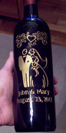 Wedding bottle design etched with gold paint.