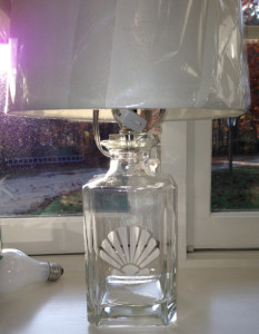 A fillable lamp etched with a shellfish.